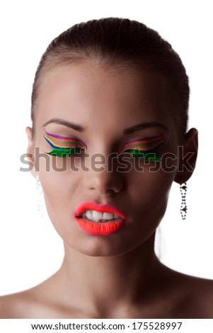 Face of beautiful girl with bright UV makeup - stock photo