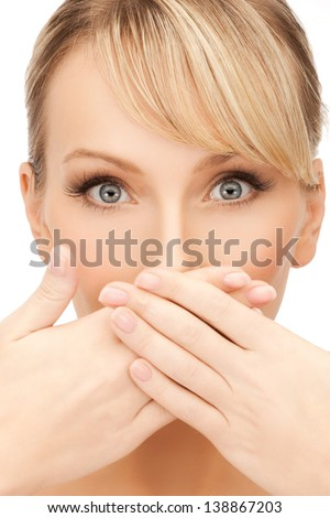 face of beautiful woman covering her mouth - stock photo