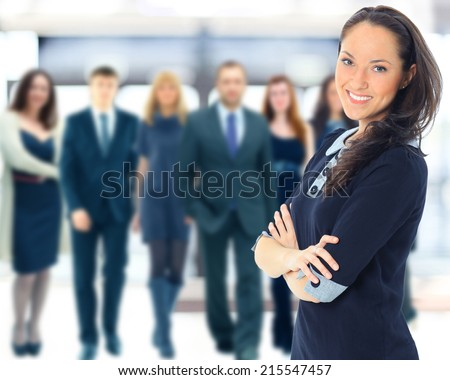 Face of beautiful woman on the background of business people  - stock photo