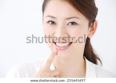 face of beautiful woman showing her teeth - stock photo
