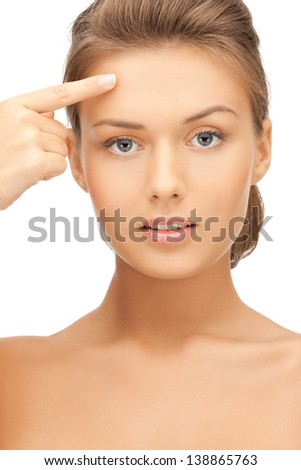face of beautiful woman touching her forehead - stock photo