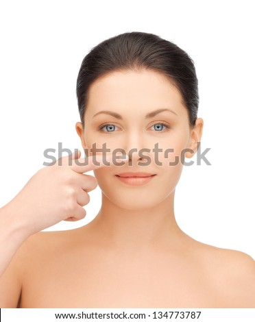 face of beautiful woman touching her nose - stock photo