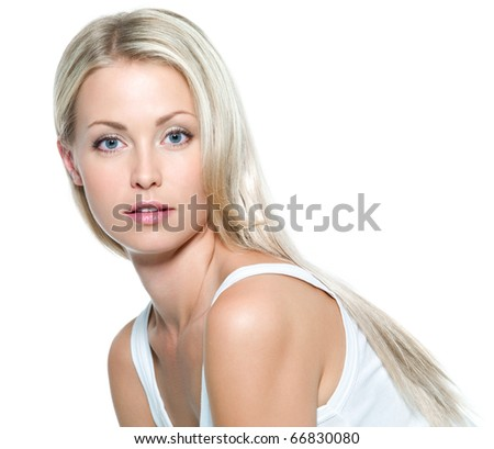 Face of  beautiful young woman with clean skin on a white background - stock photo