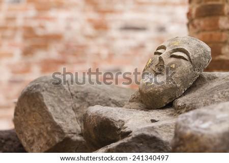 Face of buddha image at Wat Mahaeyong, Ayutthaya, Thailand - stock photo
