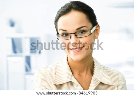 Face of clever business woman in the office - stock photo