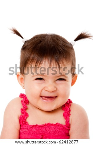 Face of cute happy smiling laughing baby infant girl with ponytails giggling, isolated. - stock photo