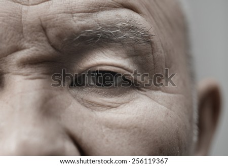 Face of elderly man looking at camera. Horizontal photo - stock photo