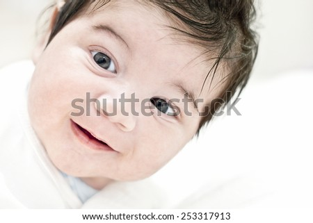 Face of happy baby, smiling, happiness, child portrait, cute smile. Portrait shot of a 2 month baby boy. - stock photo