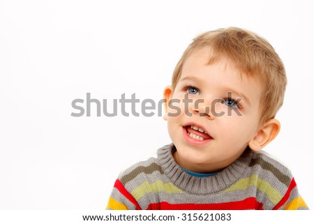 Face of happy boy in winter wear looking up on white background - stock photo