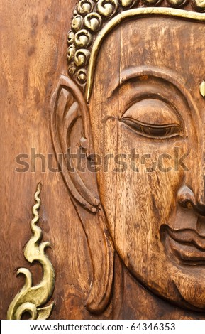 Face of Lord Buddha, native Thai style wood carving - stock photo