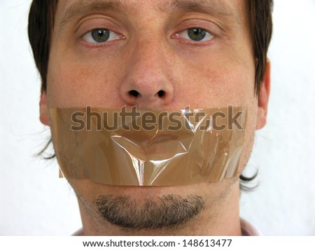 Face of  man having his mouth closed with sellotape - stock photo