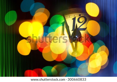 face of new year clock with colored decoration and colored stripes - stock photo