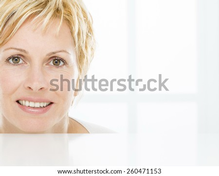 Face of nice, forty years old woman - stock photo