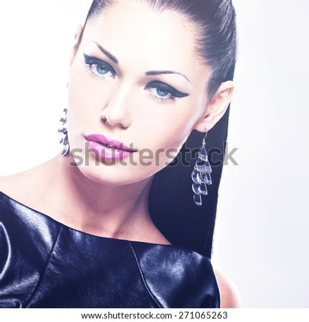 Face of the  beautiful sexy  woman with glamour fashion makeup of eyes and gloss hairstyle. Portrait of the caucasian adult girl at studio - stock photo