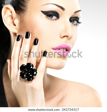 Face of the  beautiful  woman with black nails and pink lips. Pretty girl with fashion makeup - stock photo