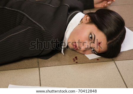 Face of the lifeless killed businesswoman in a office - stock photo