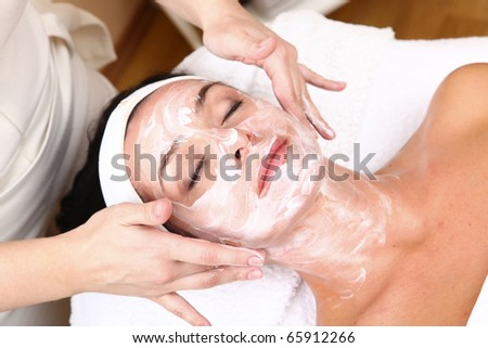 face of women getting a spa treatment - stock photo