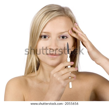 face of young blonde woman + scalpel in her hand (pure white background) - stock photo