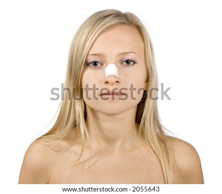 face of young woman with sticking plaster on nose (pure white background) - stock photo