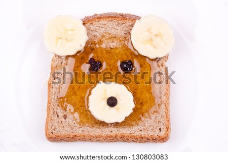 face on bread for breakfast - stock photo