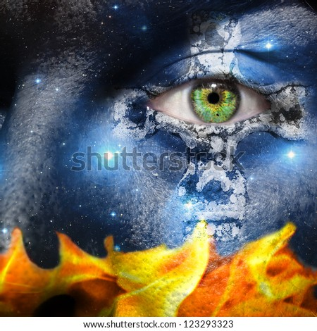 Face overlay of the seven sisters constellation with a Celtic cross centering around the green eye with a base of fire flames - stock photo