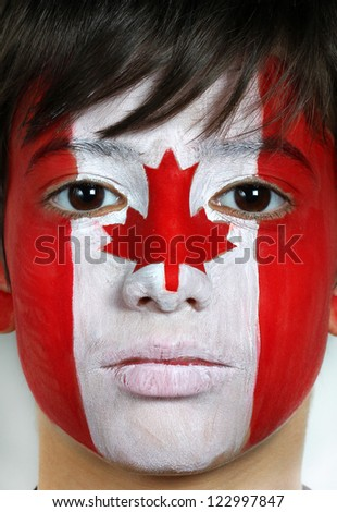 Face painting as s Canadian flag - stock photo