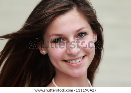 face portrait of a beautiful young girl - stock photo