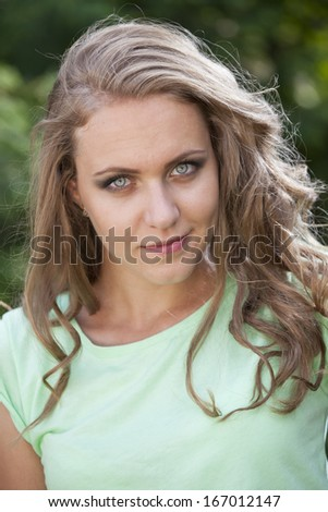 Face Portrait of happy young woman outdoor - stock photo
