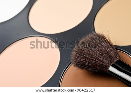 Face-powder box and black single brush - stock photo