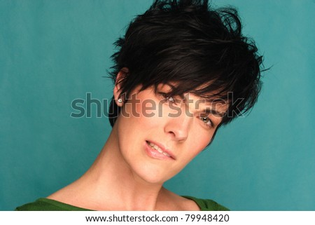 Face shot of a caucasian female showing expression. - stock photo