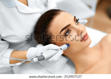 Face Skin Care. Close-up Of Woman Getting Facial Hydro Microdermabrasion Peeling Treatment At Cosmetic Beauty Spa Clinic. Hydra Vacuum Cleaner. Exfoliation, Rejuvenation And Hydratation. Cosmetology.  - stock photo