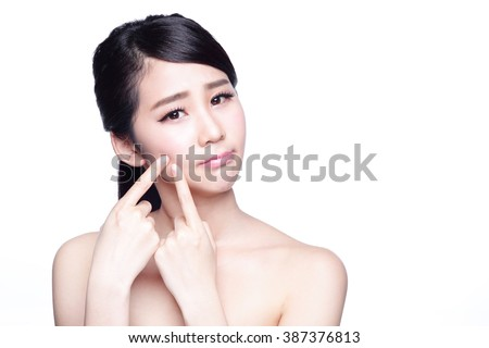 Face Skin Problem - young woman unhappy touch her skin isolated, concept for skin care, asian - stock photo