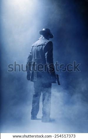 Faceless killer in the haze. - stock photo
