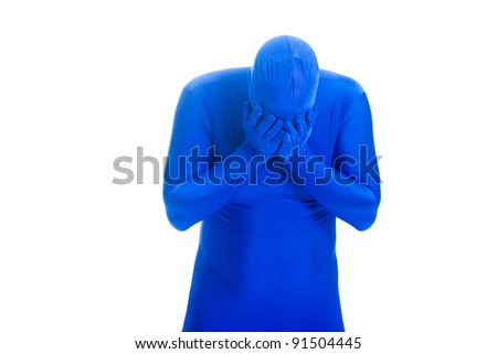 Faceless man in a blue body suit expressing sorrow by crying into his hands. - stock photo