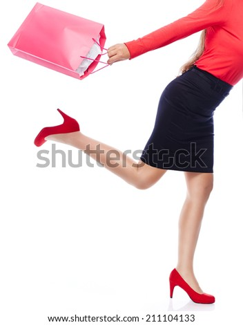 Faceless woman with shopping Bag running - stock photo