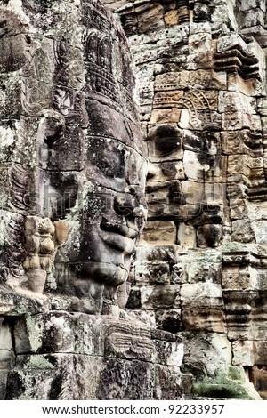 Faces of Buddha at Bayon temple, Angkor, Cambodia - stock photo