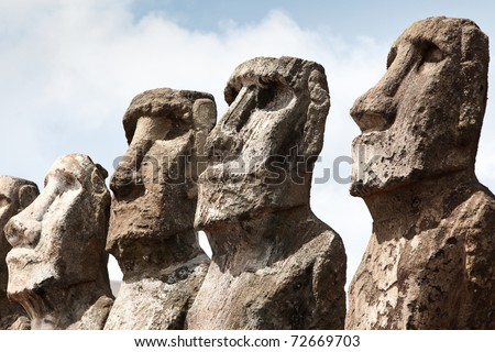 Faces of four stone moai in Easter Island on sunny day - stock photo