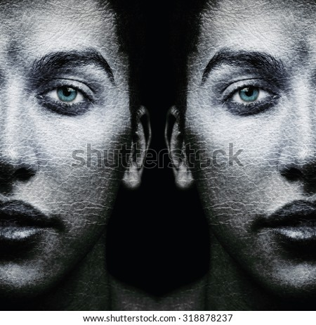 Faces of male twins with textured skin - stock photo