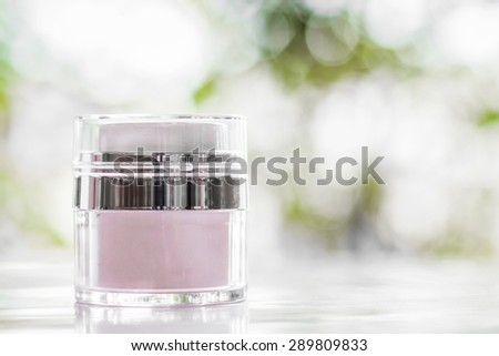 Facial and body cream on bokeh background, soft focus - stock photo