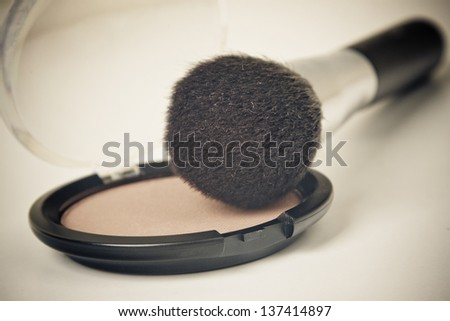 facial brush on a powder. Image has a vintage effect. - stock photo