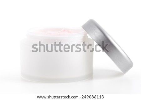 Facial cream in jar on white - stock photo