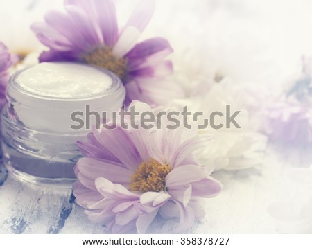 facial cream with flowers, freshness - stock photo