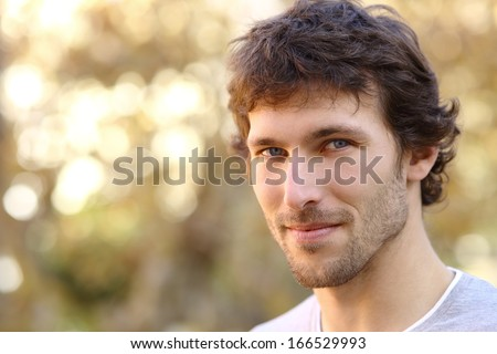 Facial portrait of an attractive adult man with an unfocused warm background                - stock photo