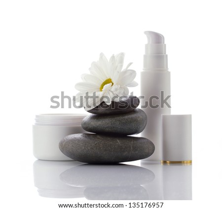facial spa-cosmetics products and white flower isolated on white - stock photo