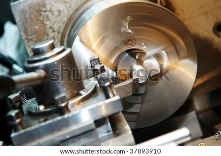 Facing operation of a metal blank on turning machine with cutting tool - stock photo