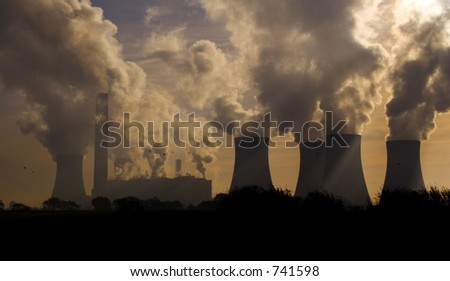 Factories and power station belching pollution. - stock photo