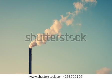 Factory chimney with white smoke - stock photo