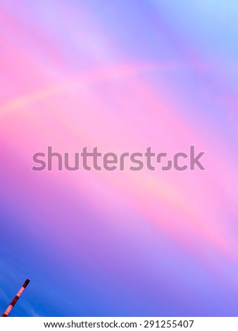 Factory chimneys and rainbow.  - stock photo