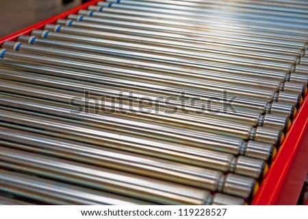 Factory Conveyor Belt Rollers - stock photo