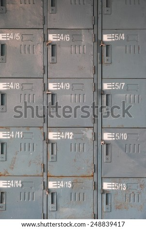 Factory employees' old grey rusty lockers - stock photo